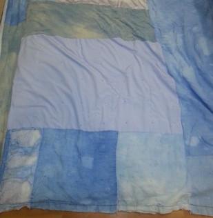 worn blue comforter