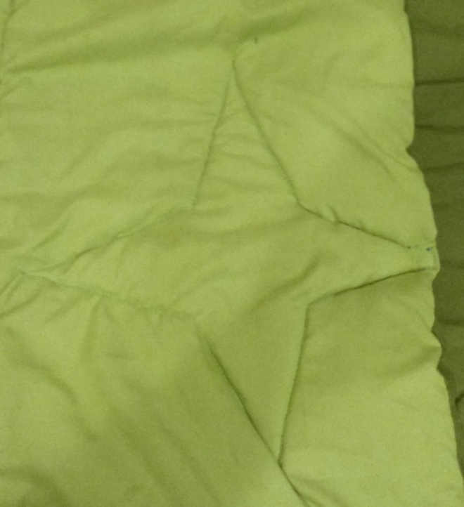 patching/mending a torn comforter with applique