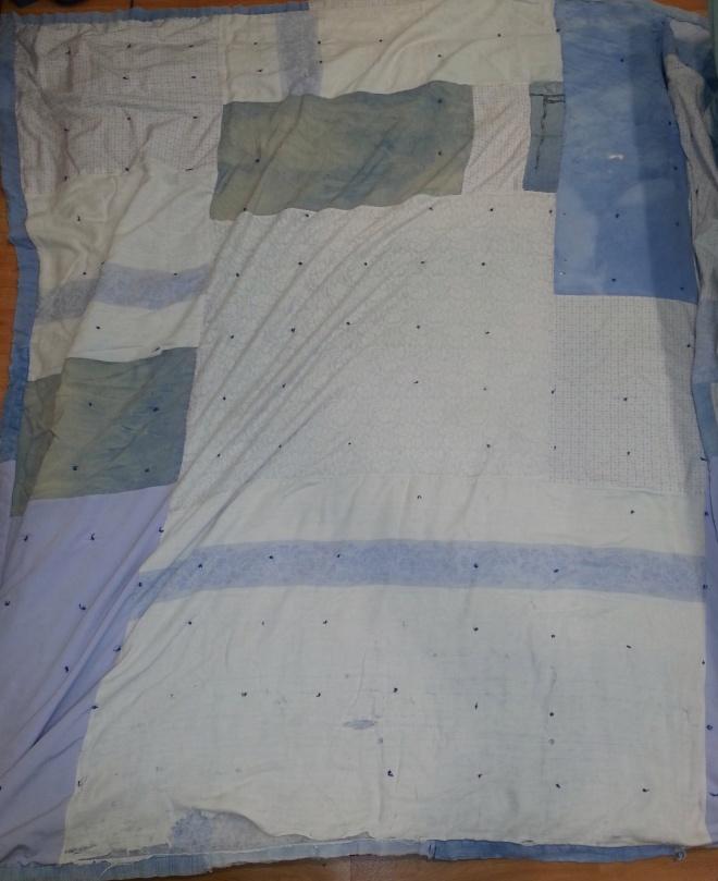 torn comforter for mending
